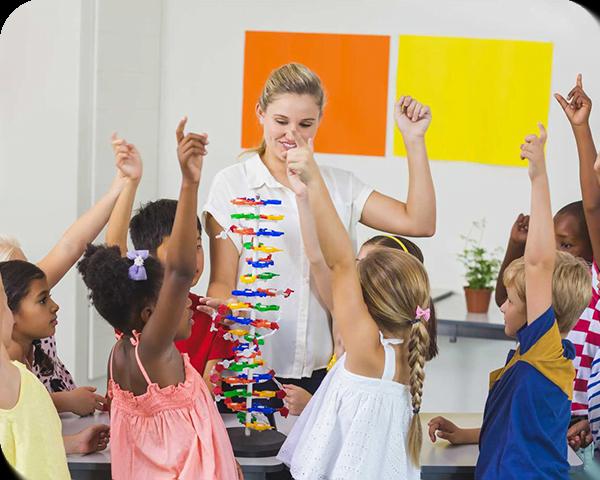 teacher-assisting-kids-in-laboratory-LX6L6WN